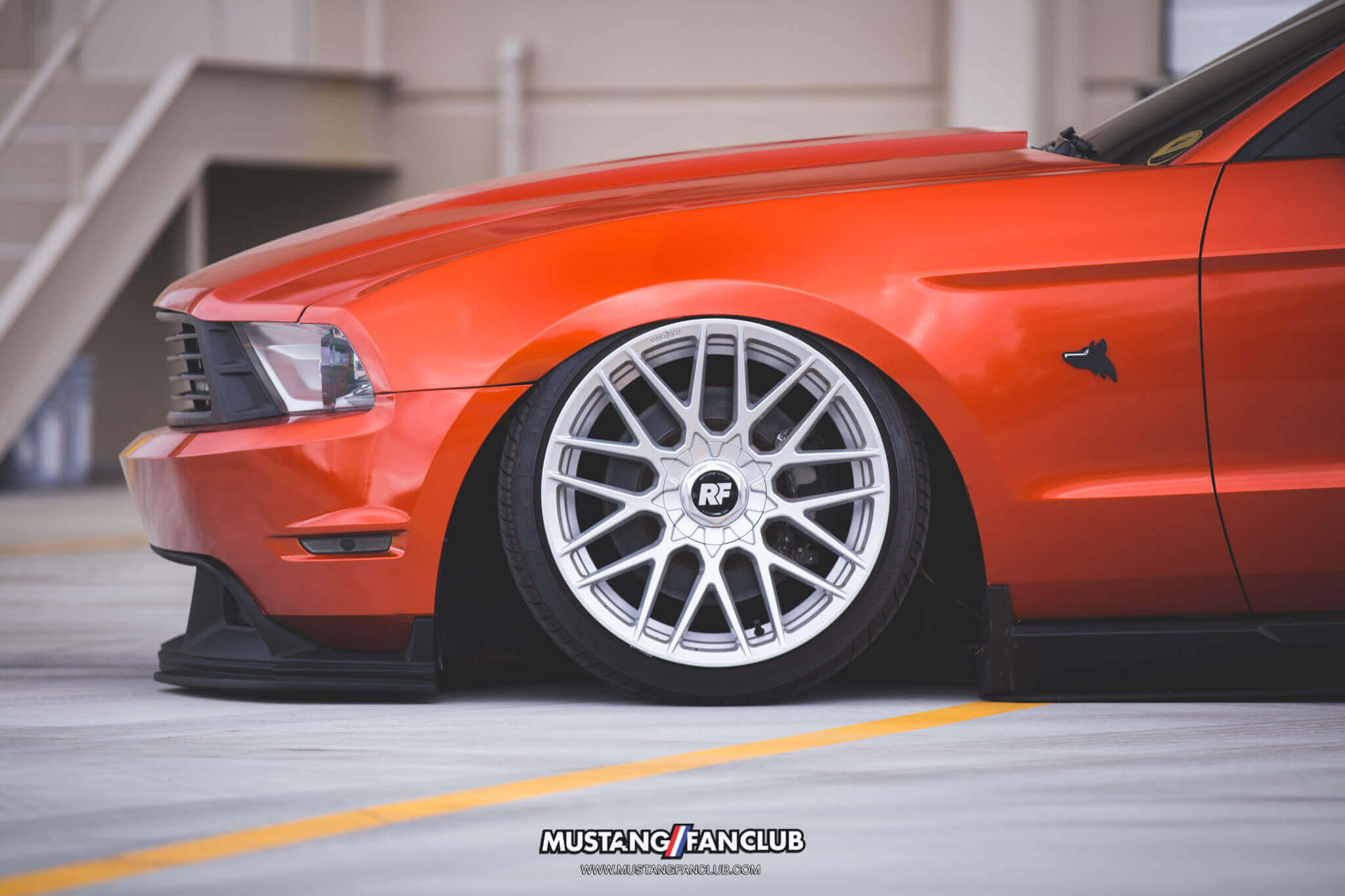 mustang fan club mustangfanclub @mustangfanclub 2011 11 mustang coyote 5.0L 5.0 wrapped bagged air suspension air lift performance rotiform wheels dillon shand RSE anything coyote badge upr products coyote emblem S197 3m 1080 fiery orange